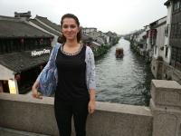 Yasmin takes a touristy photo in China