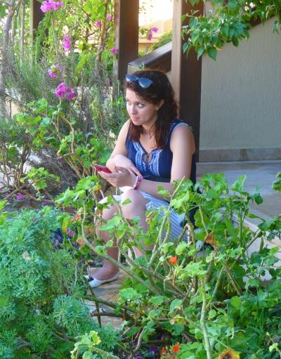 Yasmin checks her Facebook
